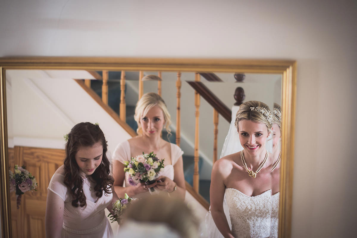 Farnham Castle Wedding Photography | Amelia & Ollie 17 Bride final touches 1