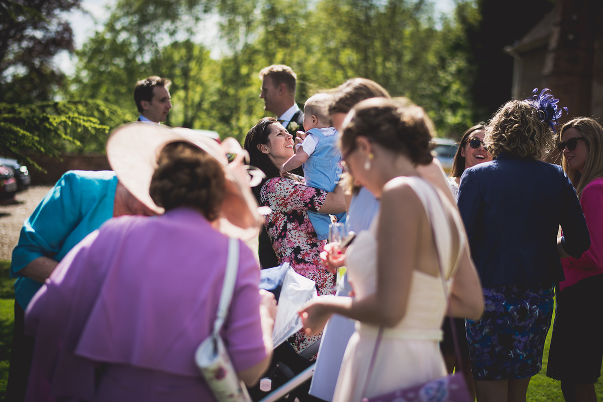 Farnham Castle Wedding Photography | Amelia & Ollie 38 laughing wedding guest 1