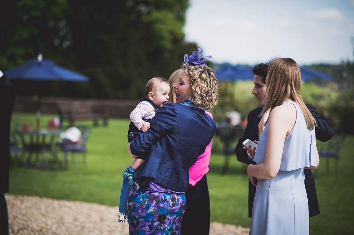 Farnham Castle Wedding Photography | Amelia & Ollie 42 bride and groom laughing 1