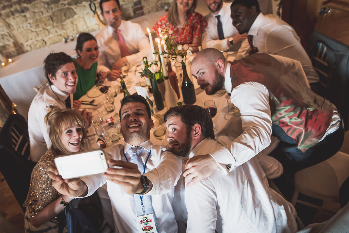 Grittenham Barn Wedding Photography | Hannah & Chris 38 laughing wedding guest 1