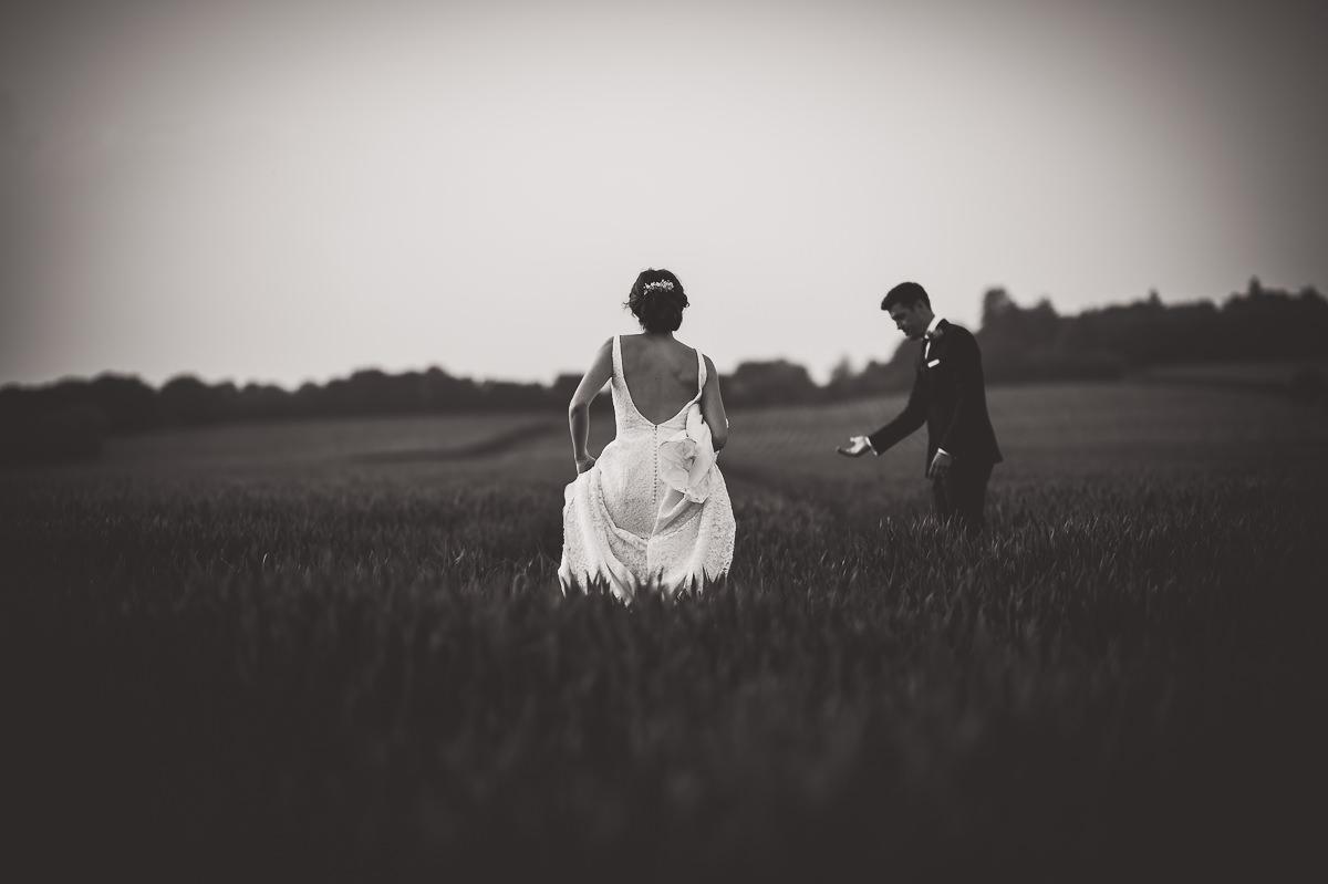 Grittenham Barn Wedding Photography | Hannah & Chris 54 Bride smiling at groom 1