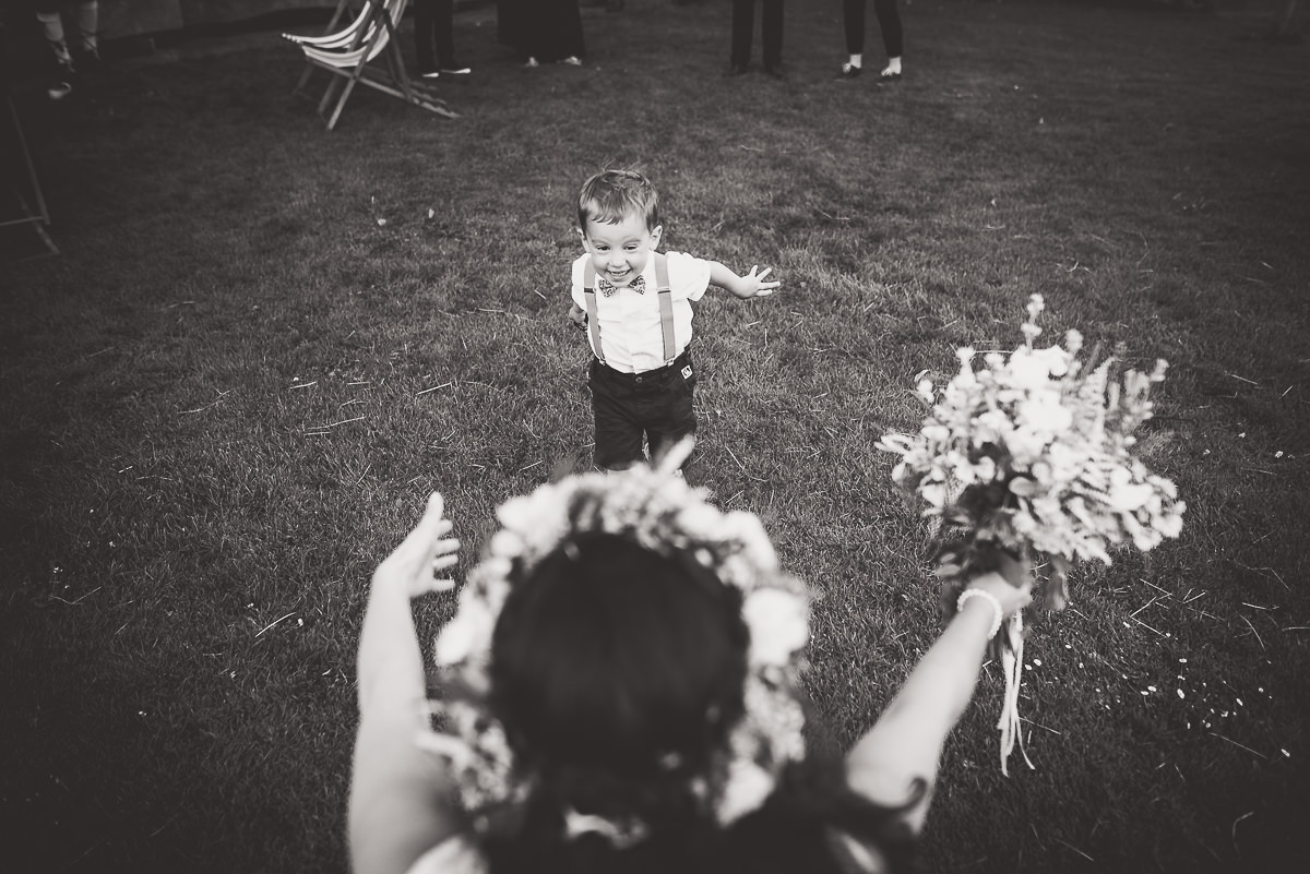 Old Greens Barn Wedding | Holly & Ben 33 Flower girl down the aisle