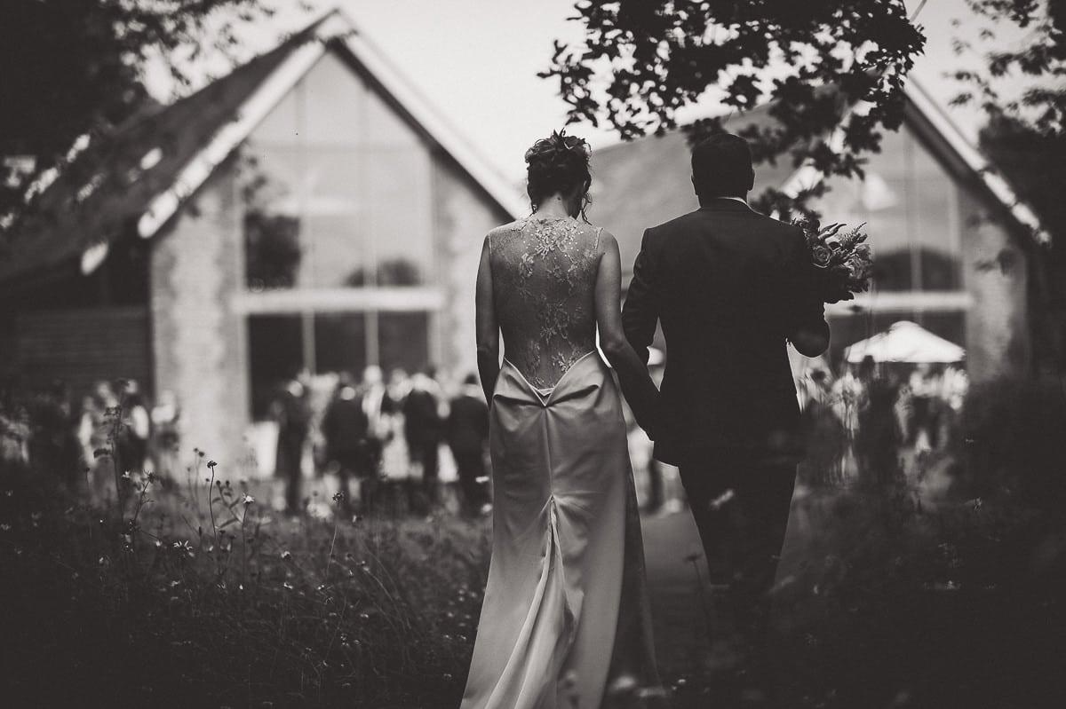 Millbridge Court Wedding Photography | Barbora & Matt 33 Flower girl down the aisle