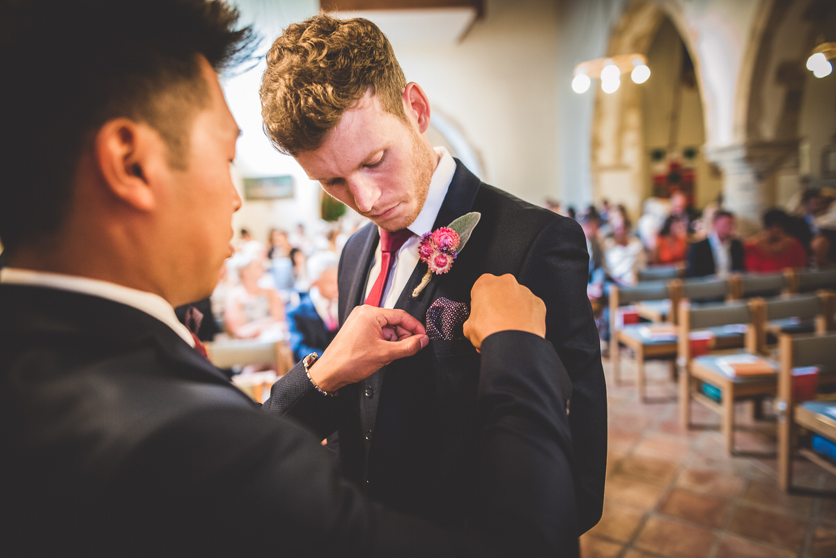 Checking the grooms suit